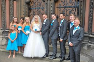 Bride & Groom with bridesmaids and ushers on church steps
