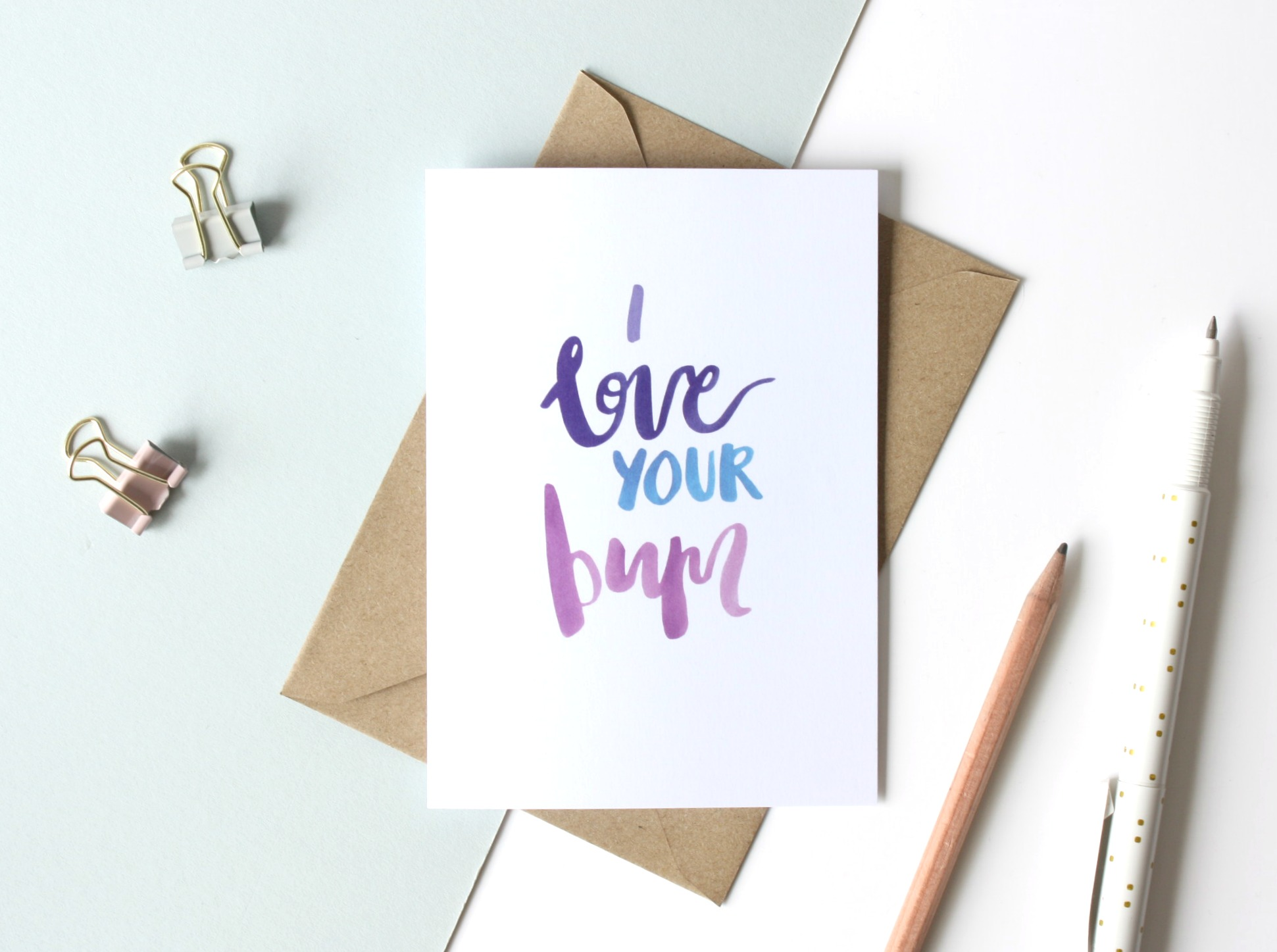 i love you're bum pink greetings card flat lay