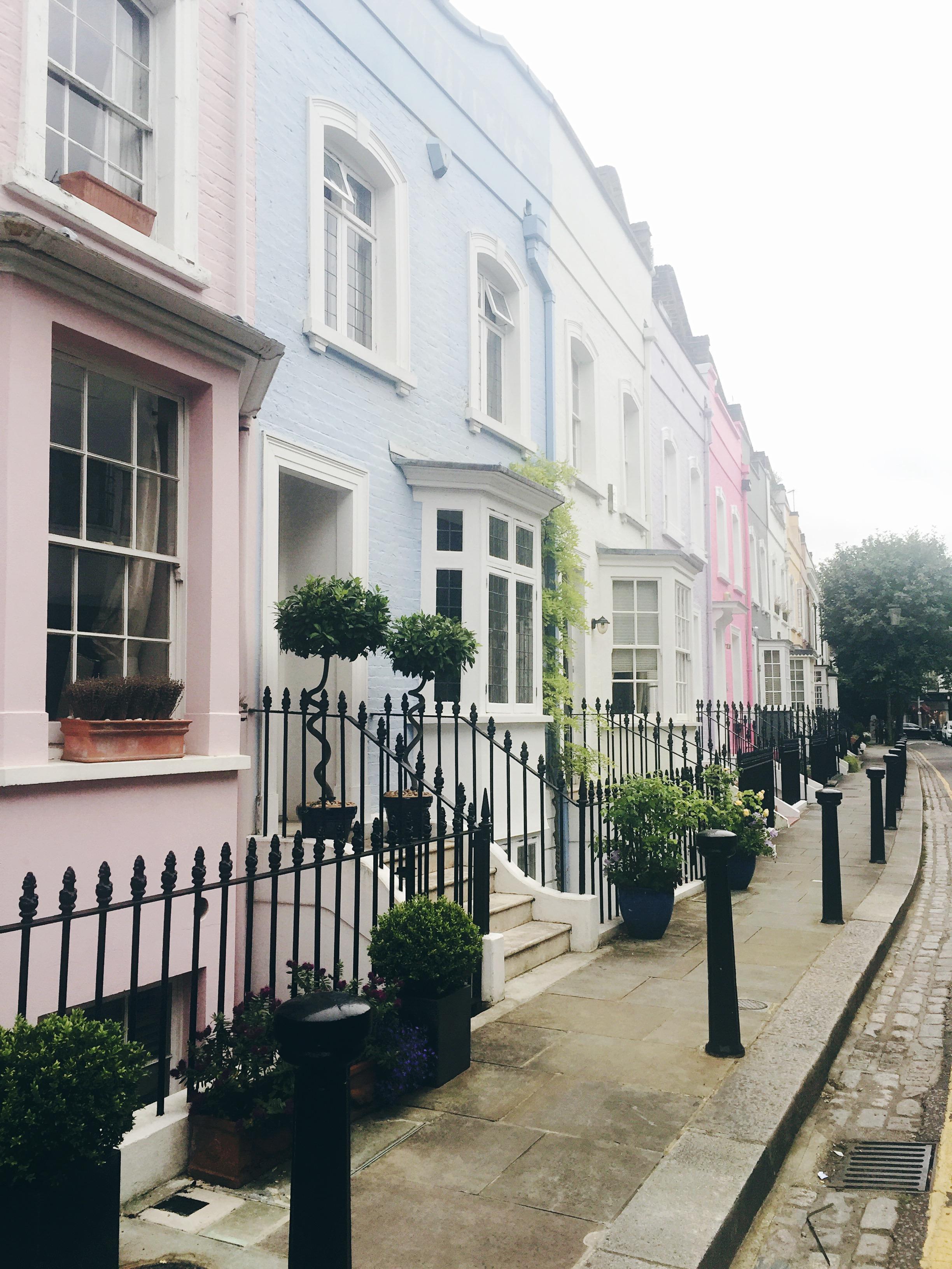 pastel coloured houses london street daphenrosa