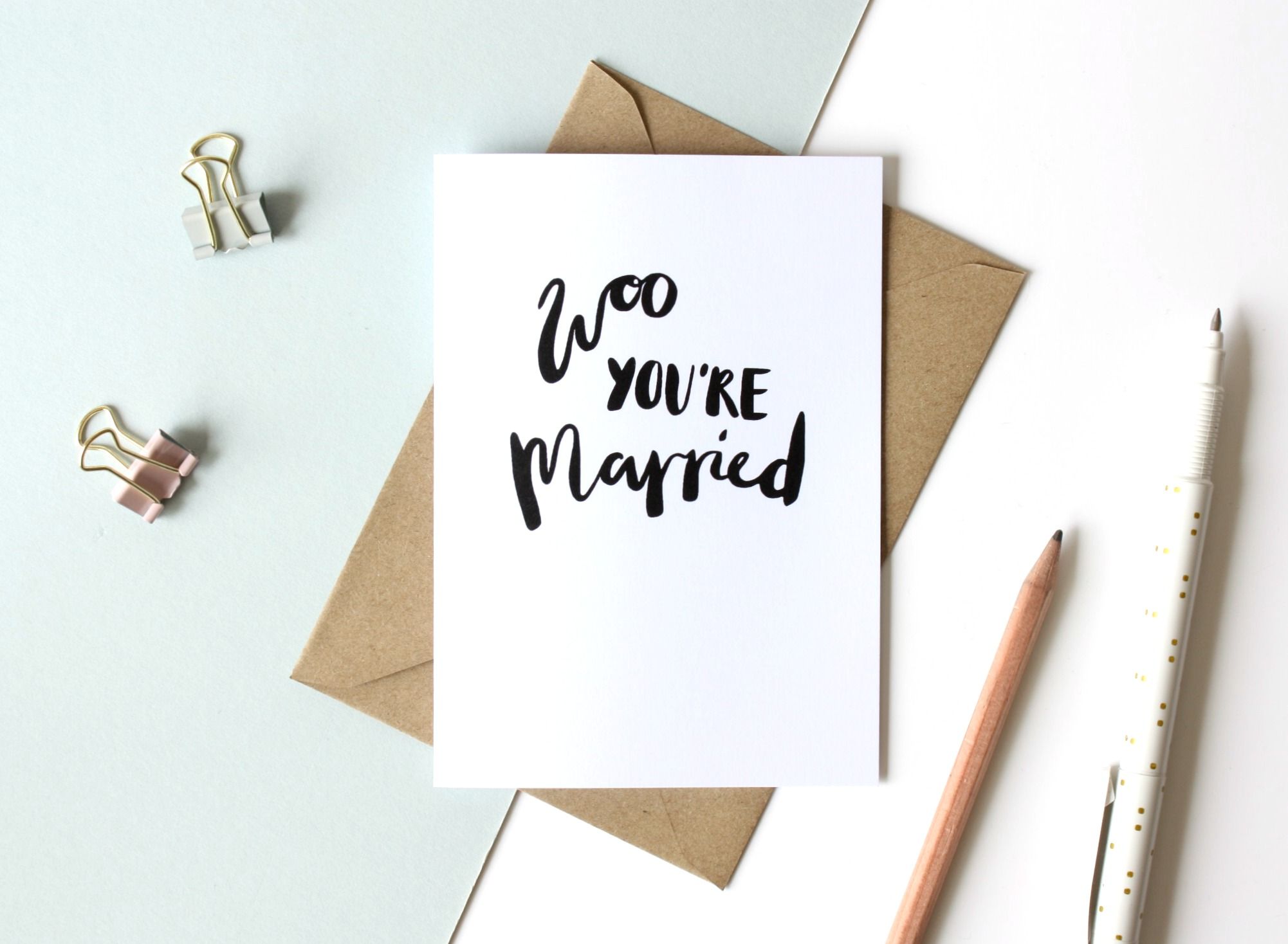 woo you're married greetings card flat lay
